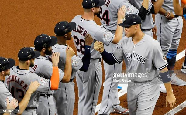 Aaron Judge of the New York Yankees and the American League greets teammates during pregame ceremonies for the 88th MLB AllStar Game against the...