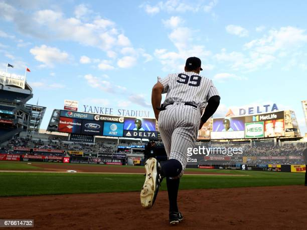Aaron Judge of the New York Yankees and the rest of the team take the field to start the game against the Toronto Blue Jays on May 2 2017 at Yankee...