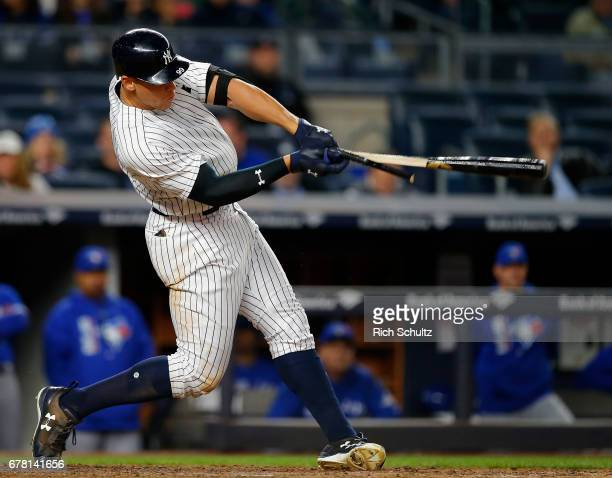 Aaron Judge of the New York Yankees breaks his bat as he hits a single in the seventh inning against the Toronto Blue Jays during a game at Yankee...