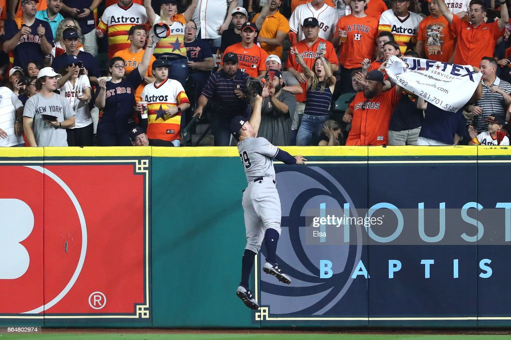 Aaron Judge #99 of the New York Yankees catches a line drive in the outfield hit by Yuli Gurriel #10 of the Houston Astros during the second inning in Game Seven of the American League Championship Series at Minute Maid Park on October 21, 2017 in Houston, Texas.