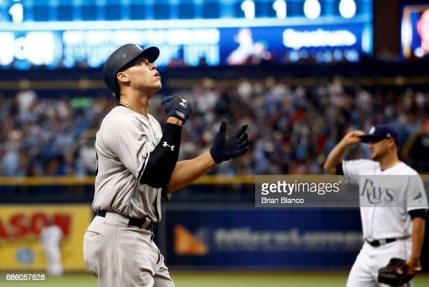 Aaron Judge of the New York Yankees celebrates as he nears home plate after hitting a home run off of pitcher Matt Andriese of the Tampa Bay Rays...