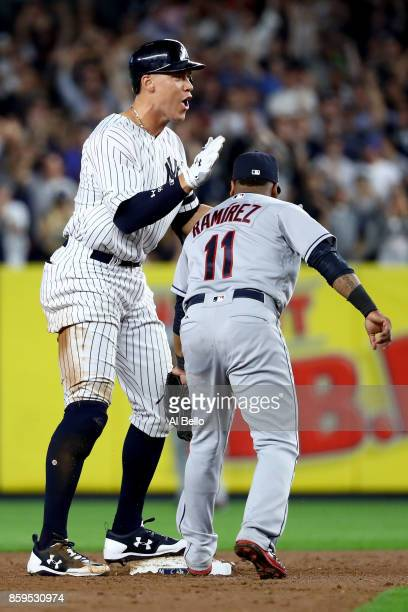 Aaron Judge of the New York Yankees celebrates from second base after hitting a double to left field to score Brett Gardner and Aaron Hicks against...