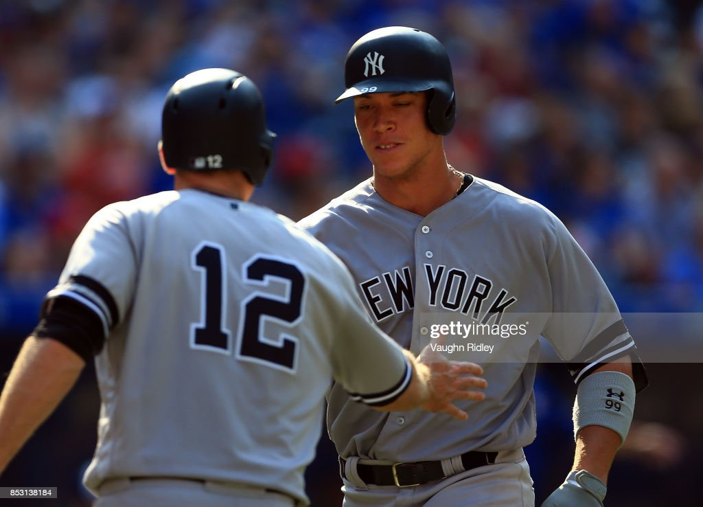 Aaron Judge #99 of the New York Yankees celebrates his 2nd home run of the game with Chase Headley #12 in the seventh inning during MLB game action against the Toronto Blue Jays at Rogers Centre on September 24, 2017 in Toronto, Canada.