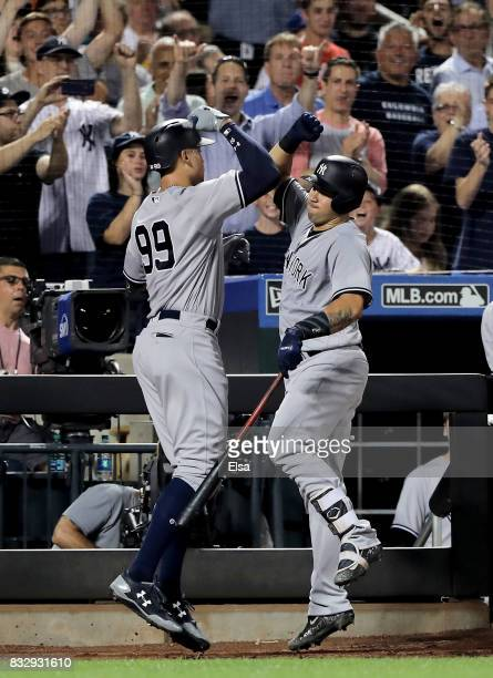 Aaron Judge of the New York Yankees celebrates his solo home run with teammate Gary Sanchez in the fourth inning against the New York Mets during...