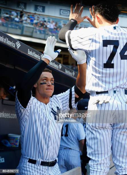 Aaron Judge of the New York Yankees celebrates his third inning home run against the Kansas City Royals with teammate Ronald Torreyes at Yankee...