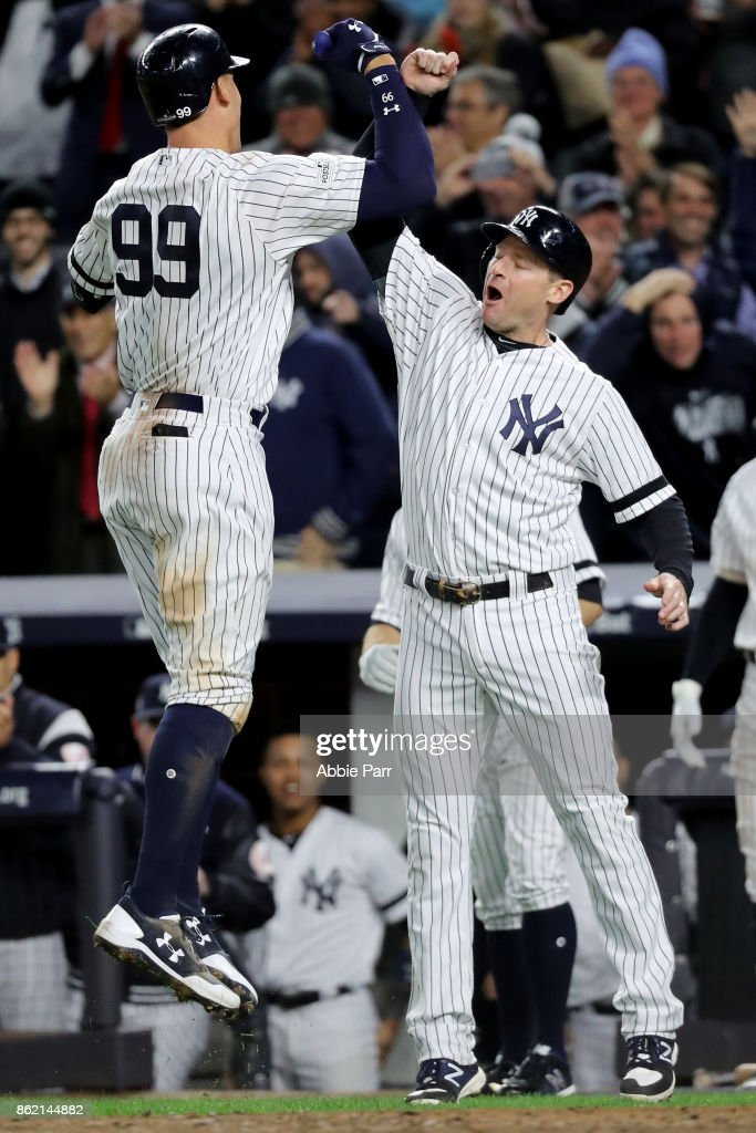 Aaron Judge #99 of the New York Yankees celebrates hitting a 3-run home run against the Houston Astros during the fourth inning with teammate Chase Headley #12 in Game Three of the American League Championship Series at Yankee Stadium on October 16, 2017 in the Bronx borough of New York City.