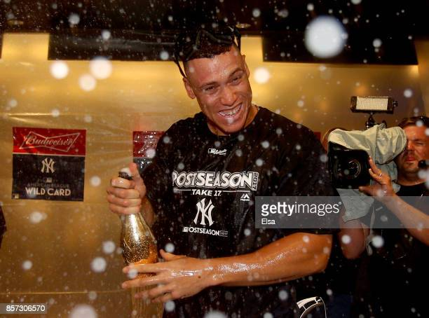 Aaron Judge of the New York Yankees celebrates in the clubhouse after defeated the Minnesota Twins during the American League Wild Card Game at...