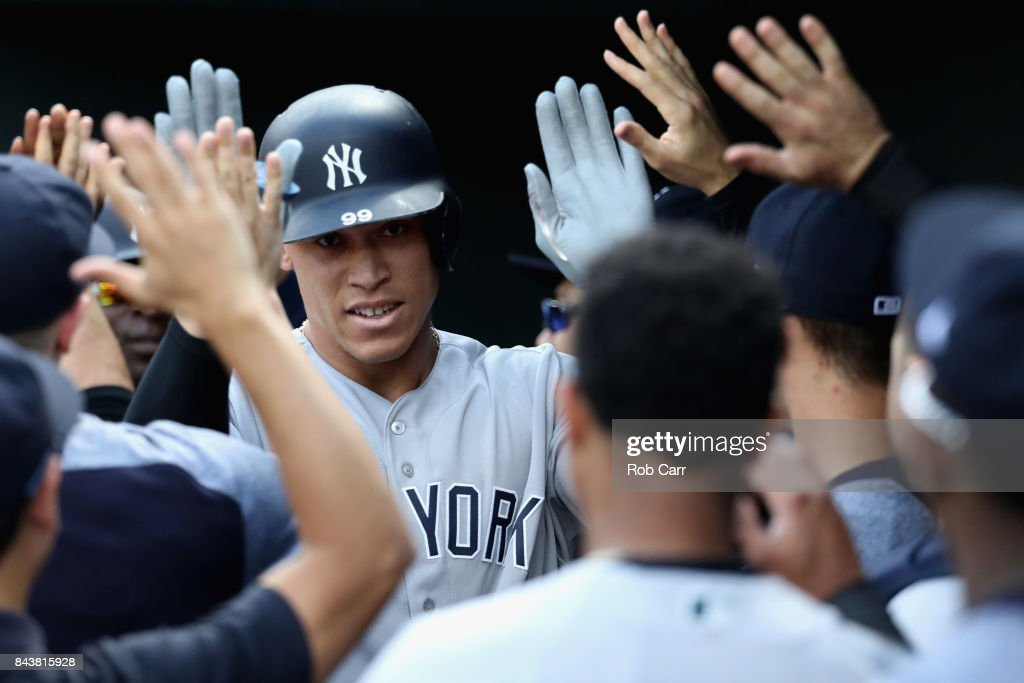 Aaron Judge #99 of the New York Yankees celebrates in the dugout after hitting a two RBI home run against the Baltimore Orioles in the first inning at Oriole Park at Camden Yards on September 7, 2017 in Baltimore, Maryland.