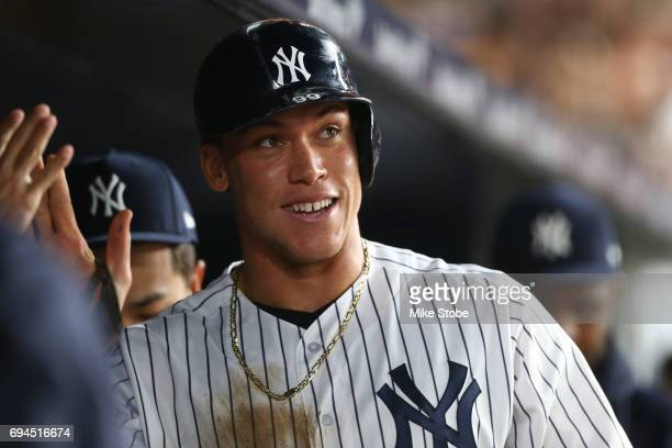 Aaron Judge of the New York Yankees celebrates in the dugout after scoring on Matt Holliday RBI double in the seventh inning against the Baltimore...