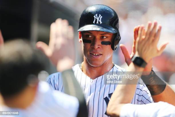 Aaron Judge of the New York Yankees celebrates in the dugout after scoring on Matt Holliday 2run single in the fourth inning against the Baltimore...