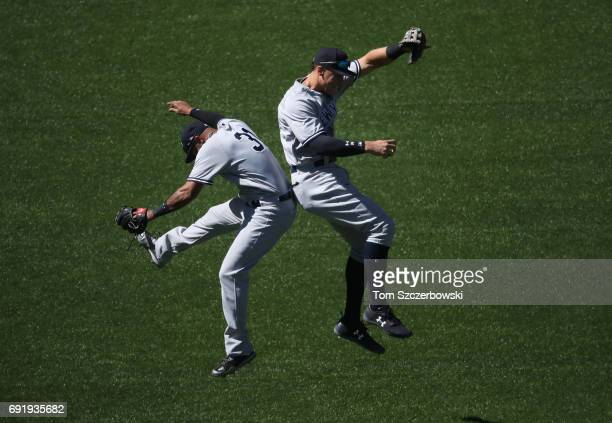 Aaron Judge of the New York Yankees celebrates their victory with Aaron Hicks during MLB game action against the Toronto Blue Jays at Rogers Centre...