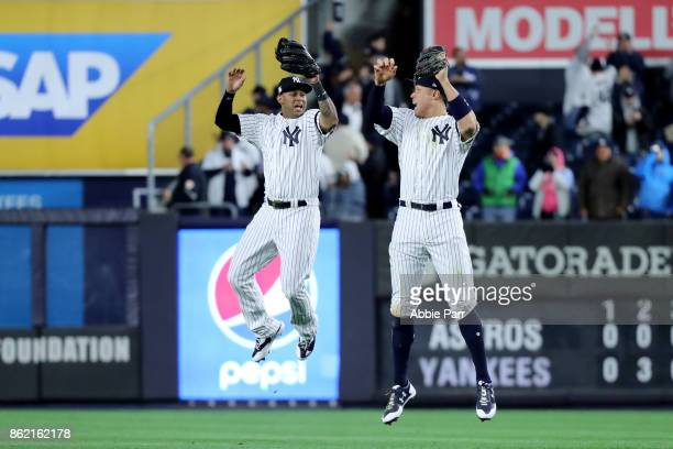 Aaron Judge of the New York Yankees celebrates with Aaron Hicks after defeating the Houston Astros in Game Three of the American League Championship...