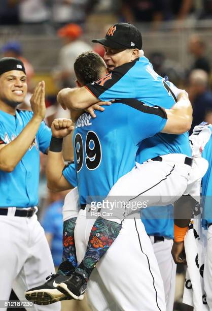 Aaron Judge of the New York Yankees celebrates with Danilo Valiente after winning the TMobile Home Run Derby at Marlins Park on July 10 2017 in Miami...