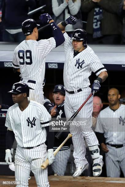 Aaron Judge of the New York Yankees celebrates with Gary Sanchez after hitting a solo home run during the seventh inning against the Houston Astros...