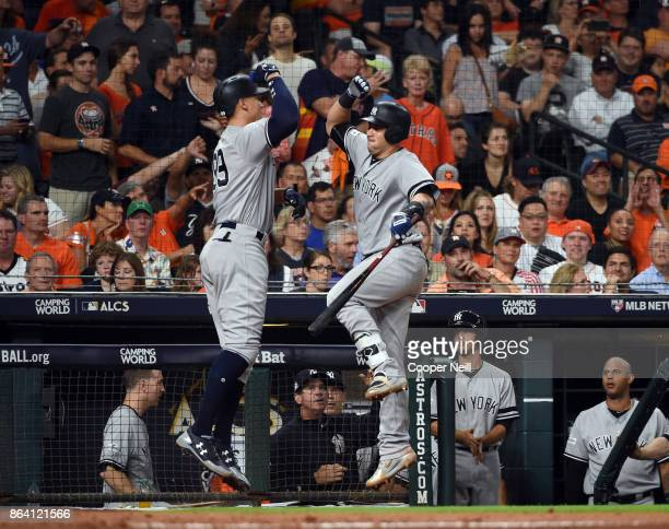 Aaron Judge of the New York Yankees celebrates with Gary Sanchez after hitting a solo home run in the eighth inning of Game 6 of the American League...
