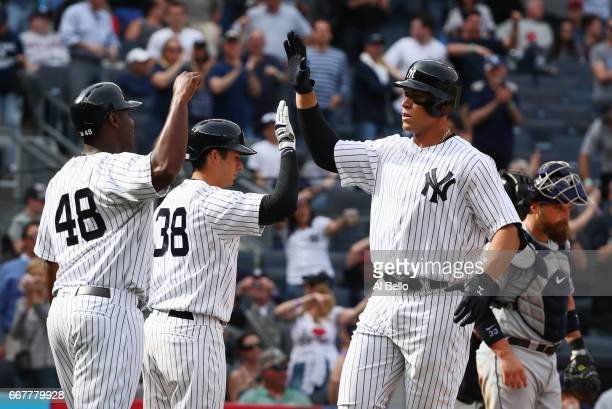 Aaron Judge of the New York Yankees celebrates with his teamates after hitting a two run home run in the seventh inning against the Tampa Bay Rays...