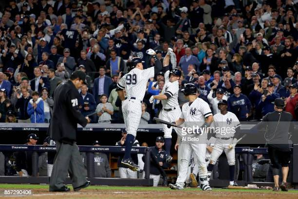 Aaron Judge of the New York Yankees celebrates with teammate Brett Gardner after hitting a two run home run against Jose Berrios of the Minnesota...