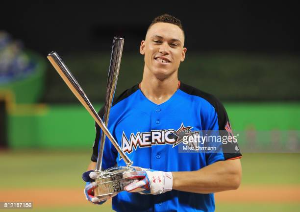 Aaron Judge of the New York Yankees celebrates with the trophy after winning the TMobile Home Run Derby at Marlins Park on July 10 2017 in Miami...