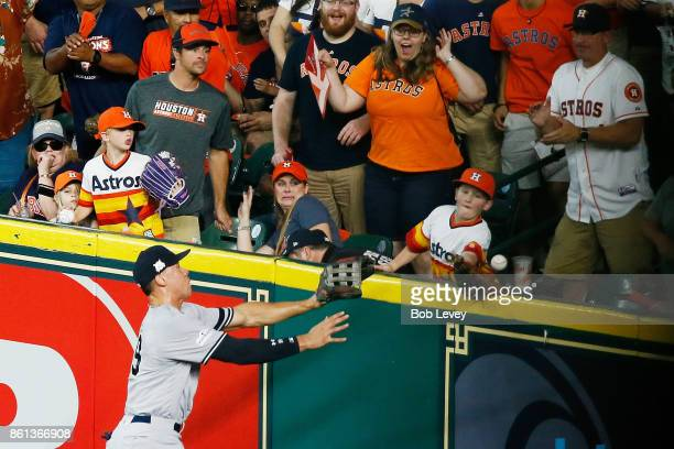 Aaron Judge of the New York Yankees fails to catch a solo homerun by Carlos Correa of the Houston Astros in the fourth inning during game two of the...