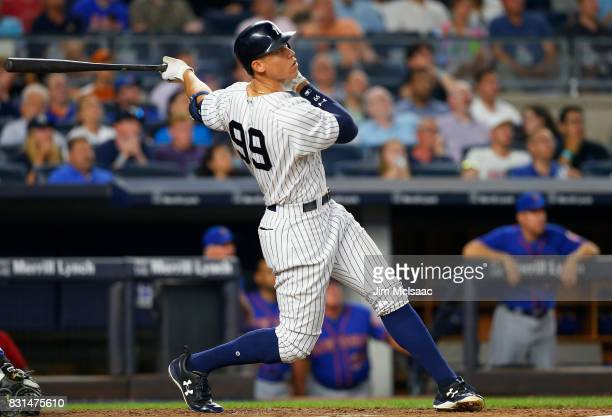 Aaron Judge of the New York Yankees follows through on a sixth inning home run against the New York Mets at Yankee Stadium on August 14 2017 in the...