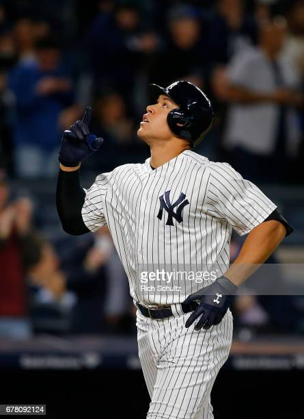 Aaron Judge of the New York Yankees gestures after he hit a tworun home run in the third inning against the Toronto Blue Jays during a game at Yankee...