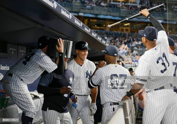 Aaron Judge of the New York Yankees gives a mock interview in the dugout after hitting his 51st home run of the season in the first inning with...