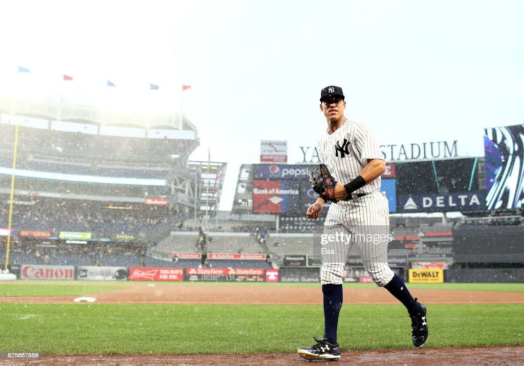Aaron Judge #99 of the New York Yankees heads for the dugout as a rain delay before the start of the eighth inning against the Detroit Tigers on August 2, 2017 at Yankee Stadium in the Bronx borough of New York City.