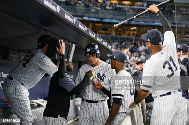 Aaron Judge of the New York Yankees hit his 51st home run of the season in the first inning and when he got to the dugout teammates did a mock...