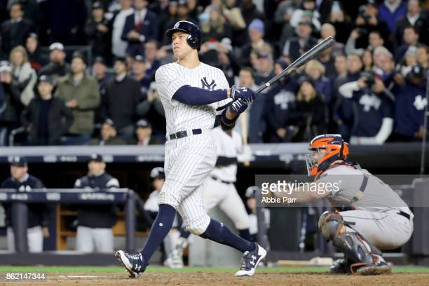 Aaron Judge of the New York Yankees hits a 3run home run during the fourth inning against the Houston Astros in Game Three of the American League...