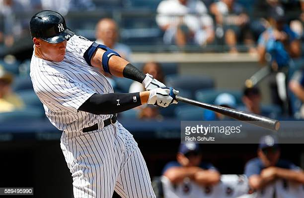 Aaron Judge of the New York Yankees hits a home run against the Tampa Bay Rays during the third inning of a game at Yankee Stadium on August 14 in...
