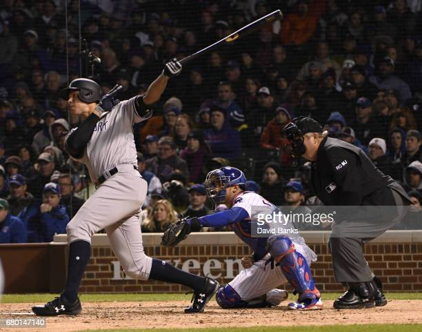 Aaron Judge of the New York Yankees hits a RBI triple against the Chicago Cubs during the seventh inning on May 7 2017 at Wrigley Field in Chicago...
