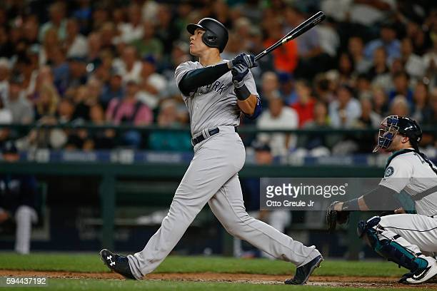 Aaron Judge of the New York Yankees hits a sacrifice fly scoring Mark Teixeira in the sixth inning against the Seattle Mariners at Safeco Field on...