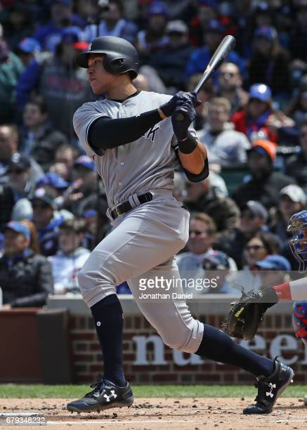 Aaron Judge of the New York Yankees hits a single in the 2nd inning against the Chicago Cubs at Wrigley Field on May 5 2017 in Chicago Illinois