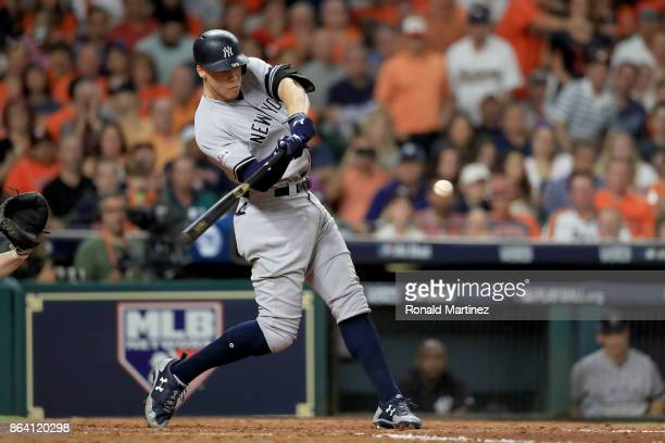 Aaron Judge of the New York Yankees hits a solo home run against Brad Peacock of the Houston Astros during the eighth inning in Game Six of the...
