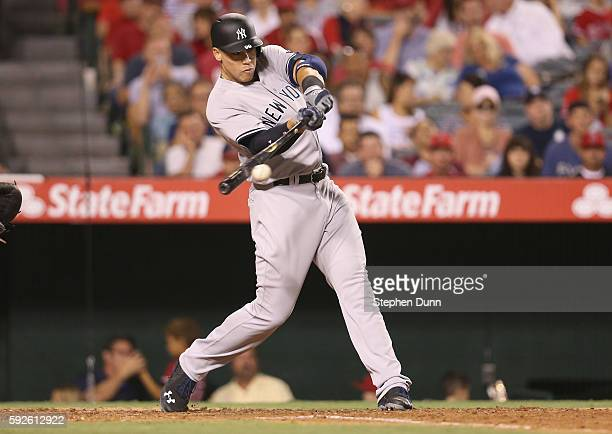 Aaron Judge of the New York Yankees hits a two run single in the sixth inning against the Los Angeles Angels of Anaheim at Angel Stadium of Anaheim...