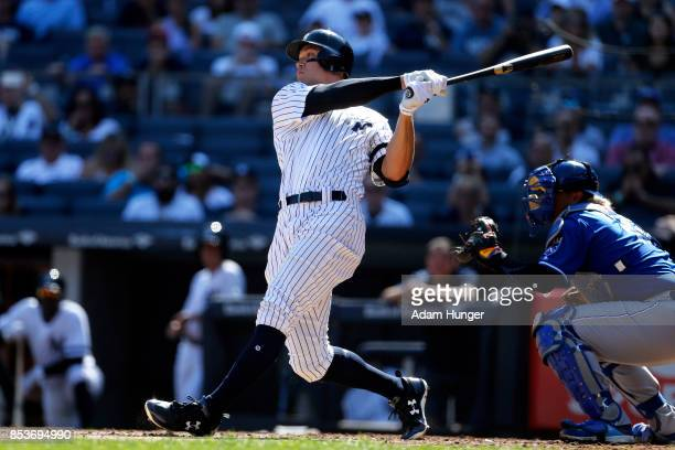 Aaron Judge of the New York Yankees hits a tworun home run in front of Salvador Perez of the Kansas City Royals during the third inning at Yankee...
