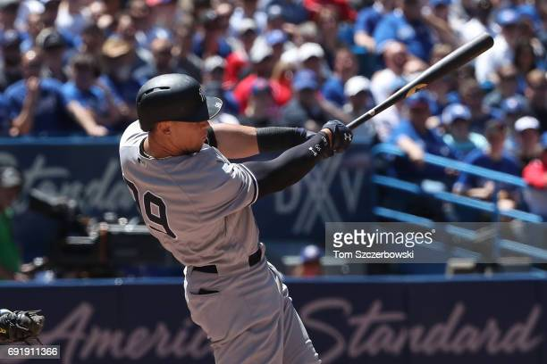 Aaron Judge of the New York Yankees hits an RBI double in the third inning during MLB game action against the Toronto Blue Jays at Rogers Centre on...