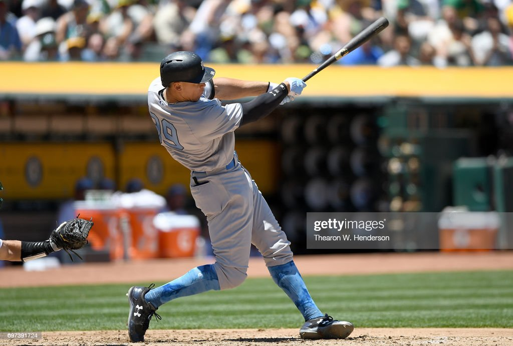 Aaron Judge #99 of the New York Yankees hits an rbi single against the Oakland Athletics in the top of the third inning at Oakland Alameda Coliseum on June 18, 2017 in Oakland, California.