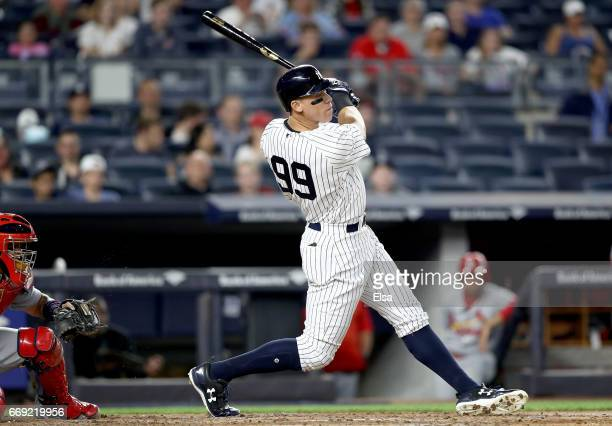 Aaron Judge of the New York Yankees hits an RBI triple in the second inning as Yadier Molina of the St Louis Cardinals defends on April 16 2017 at...