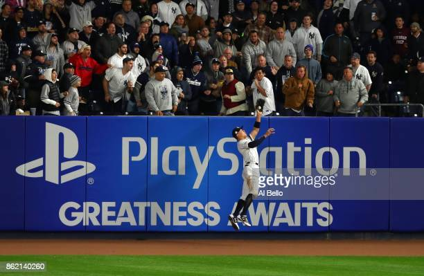 Aaron Judge of the New York Yankees hits the wall while making a catch against the Houston Astros during the fourth inning in Game Three of the...