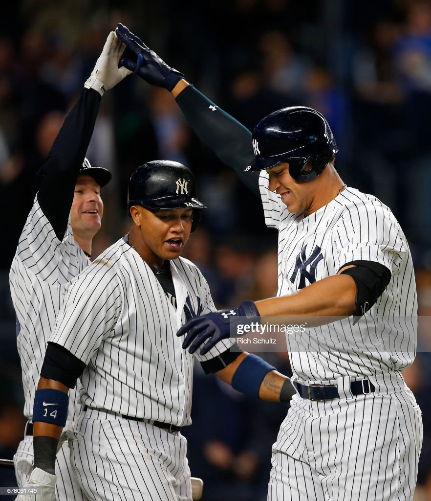 Aaron Judge #99 of the New York Yankees is congratulated by Chase Headley #12 and Starlin Castro #14 after he hit a two-run home run in the third inning against the Toronto Blue Jays during a game at Yankee Stadium on May 3, 2017 in the Bronx borough of New York City.