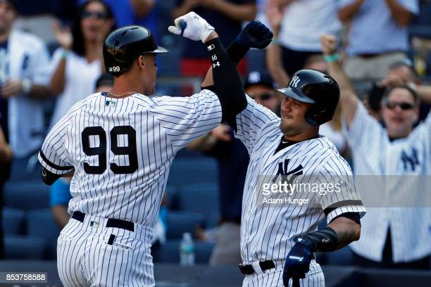 Aaron Judge of the New York Yankees is congratulated by Gary Sanchez of the Yankees after hitting solo home run against the Kansas City Royals during...