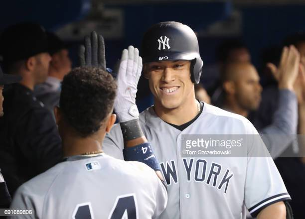 Aaron Judge of the New York Yankees is congratulated by Starlin Castro after hitting a tworun home run in the sixth inning during MLB game action...