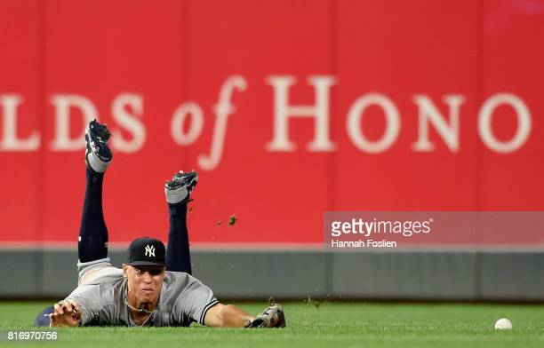 Aaron Judge of the New York Yankees is unable to catch a single hit by Joe Mauer of the Minnesota Twins during the eighth inning of the game on July...