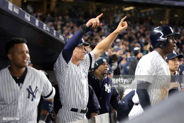 Aaron Judge of the New York Yankees points to Gary Sanchez at second base after scoring a run in the eighth inning during Game 4 of the American...