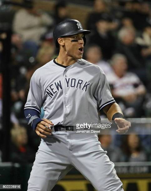 Aaron Judge of the New York Yankees reacts after he scores a run in the 8th inning against the Chicago White Sox at Guaranteed Rate Field on June 27...