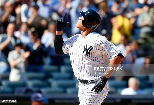 Aaron Judge of the New York Yankees reacts after his fourth inning home run against the Tampa Bay Rays on Opening Day at Yankee Stadium on April 10...