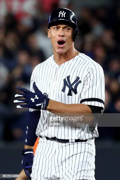 Aaron Judge of the New York Yankees reacts after hitting a double during the eighth inning against the Houston Astros in Game Four of the American...