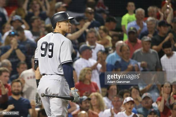 Aaron Judge of the New York Yankees reacts after striking out during a game against the Boston Red Sox at Fenway Park on August 19 2017 in Boston...