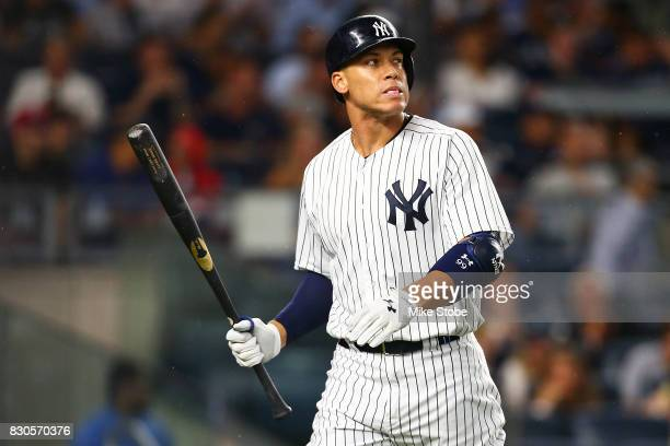 Aaron Judge of the New York Yankees reacts after striking out in the third inning with a man on second base against the Boston Red Sox at Yankee...